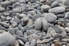 Grey stones on the beach stock image