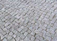 Grey stones pavement Stock Images