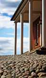 Grey stones, white columns and blue skies Stock Photos