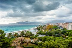 Grey stormy sky over the coast of Savona, Italy. Grey stormy sky over the green coast of Savona, Italy Stock Images
