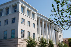 Grey Stucco Building with White Columns Stock Image