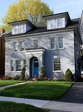Grey stucco house with dormers Stock Images