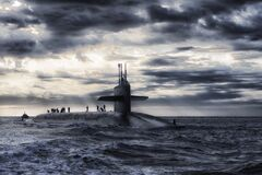 Grey Submarine in Body of Water Under Cloudy Sky Royalty Free Stock Images