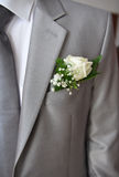 Grey suit of a groom. With boutonniere and tie close-up Royalty Free Stock Images