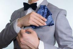 Grey suit plaid texture, bowtie, pocket square. Man in grey suit, plaid texture, blue bowtie and pocket square, close up white background Stock Photos