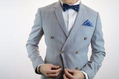 Grey suit plaid texture, bowtie, pocket square Stock Photos