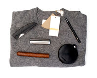 Grey sweater with goods over white stock images