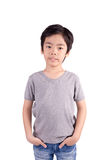 Grey T-shirt on a cute boy, isolated on white Stock Image