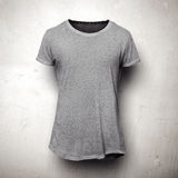 Grey t-shirt isolated on the grey background Royalty Free Stock Photography
