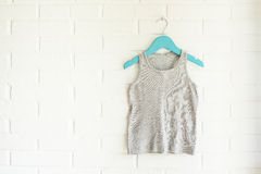 Grey tank top hanging on a aguamarine hanger Royalty Free Stock Photography