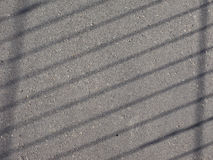 Grey tarmac texture background. Grey tarmac texture useful as a background with rail shawod royalty free stock image