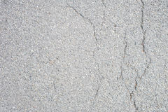 Grey tarred floor with flaws Stock Photography