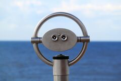 Grey Telescope by the Sea Royalty Free Stock Image