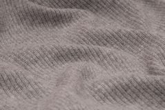 Grey textile background, grey  knitted fabric,. Grey textile background, the grey  knitted fabric Royalty Free Stock Images
