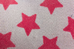 Grey textile with printed red stars Royalty Free Stock Photos