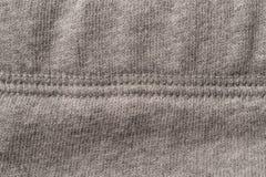 Grey Textile Seam Swatch. Grey cotton fabric swatch with seam Stock Image