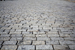 Grey texture of cobblestone road, red square Stock Photography