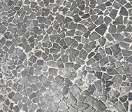 Grey texture with cracks stock images