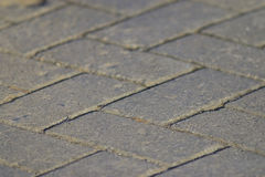 Grey texture tile on roadway Royalty Free Stock Image