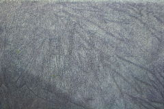 Grey textured background. Grey fabric background with slight graduation Stock Photography