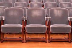 Grey theater seats Stock Photo