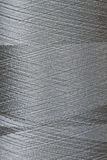 Grey thread in spool Stock Images