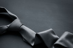 Grey tie on dark background Stock Photography