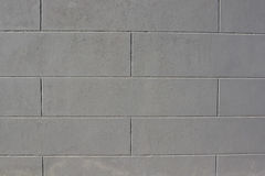 Grey tiled brick wall texture background Royalty Free Stock Photos