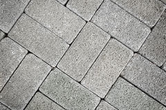 Grey tiles give a harmonic pattern. At the ground royalty free stock image