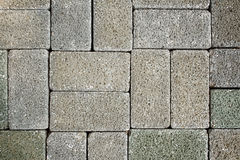 Grey tiles give a harmonic pattern at the ground. For background royalty free stock images