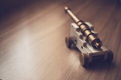 Grey Toy Cannon on a Beige Wooden Surface Stock Image