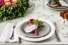 Christmas Table Setting. Grey and Traditional Red and Green Christmas Table Setting royalty free stock image