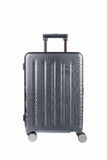 Grey travel luggage isolated. Travel plastic suitcase and wheels isolated on white with clipping path Stock Image