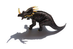 Grey triceratops toy with shadow on white background. Grey triceratops toy with shadow on a white background Royalty Free Stock Photo