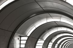 Grey tunnel with yellow lighting. Grey tunnel with yellow lighting at subway. Abstraction Royalty Free Stock Photography