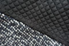 Grey tweed and black polyester sewn together. Grey tweed and black polyester fabric sewn together Stock Image