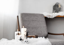 Grey upholstered chair in Halloween setting Stock Photography