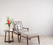 Grey upholstered chair Royalty Free Stock Images