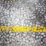 Grey urban ground with yellow stripe Royalty Free Stock Photo
