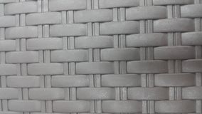 Grey view of colorful plastic woven stripes. Grey plastic woven stripes of traditional bed, chair or sitting stool used in rural areas stock images