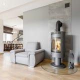 Grey villa interior with fireplace Royalty Free Stock Photos