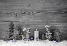 Grey and violet christmas decoration with moose and candle on ol Stock Photo