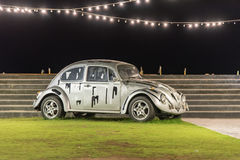 Grey volkswagen beetle car with lighting Royalty Free Stock Image