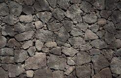 Grey stones wall. Grey vulcanic big stones wall stock photography