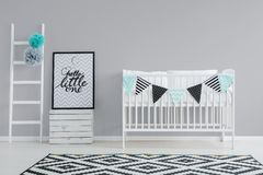 Grey wall in baby room. Grey wall and white furniture in baby room Stock Photos
