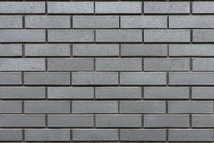 Grey wall with clinker bricks Stock Photos