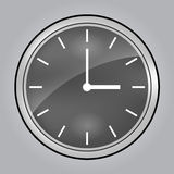 Grey wall clock at 3 o'clock Stock Images