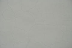 Grey wall with cracks Royalty Free Stock Images