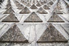 Grey wall with pyramid texture Stock Photo