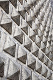 Grey wall with pyramid texture Stock Images